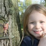 Fairy tale door with fairy in tree trunk
