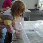 putting weights in the paper boat at winchester science centre