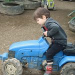 ride on tractor toy at farmer gows