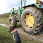 green tractor at farmer gows