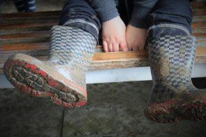 muddy wellington boots
