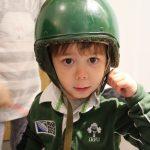 Cody wearing a green soldiers helmet