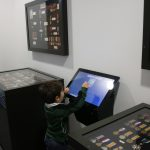 interactive screen surrounded by military medals