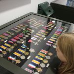 medals in display cabinet