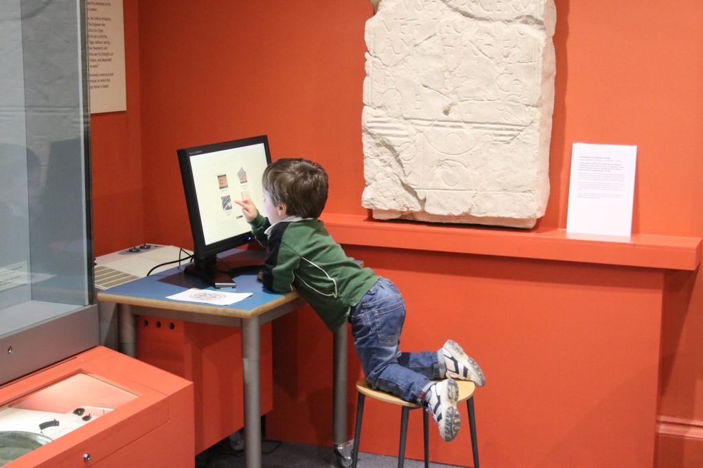 Cody using the interactive screen at The Oxfordshire Museum