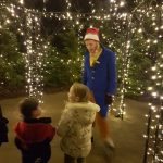 Walkway to Santa's grotto lit with fairy lights