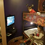 kids playing xbox in their hotel room