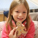 Lois holding her gingerbread man