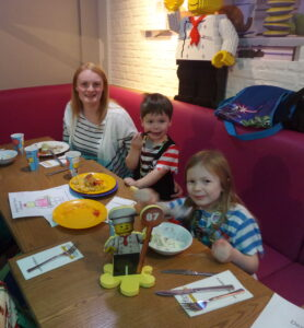 katie and kids eating in the Bricks restaurant