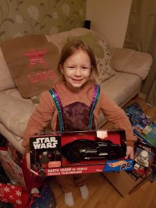 Lois holding Star Wars RC car in box on christmas morning