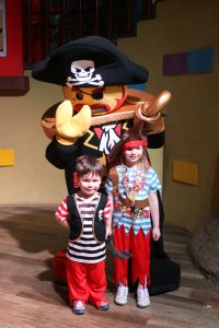 kids with lego pirate character at legoland hotel