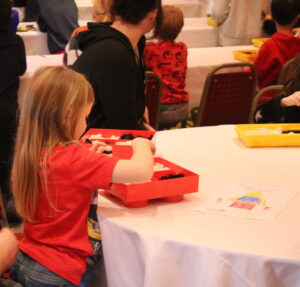 lois building lego at a table