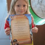lois holding her pirate treasure trail map at the legoland hotel