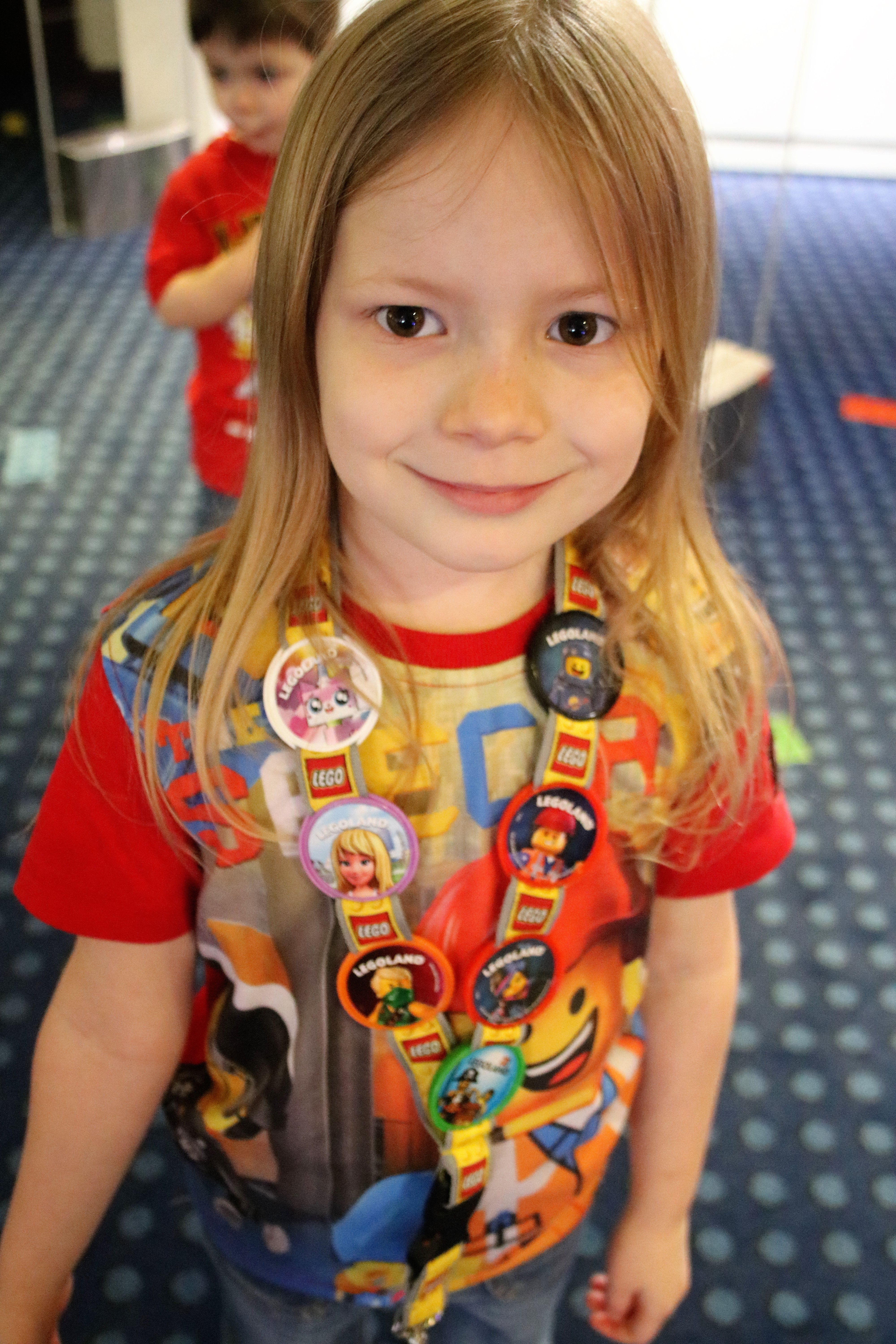 Lois wearing her Merlin pop badges lanyard