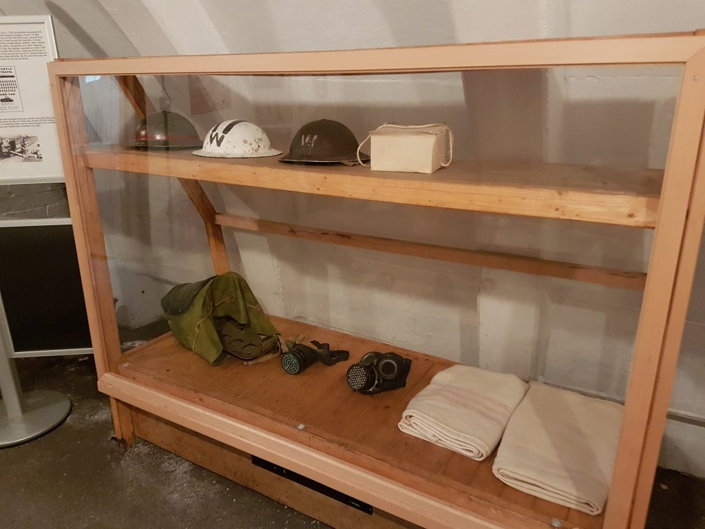 display box in air raid shelter with soldiers hats