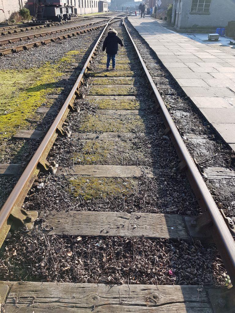 cody walking along the railway track