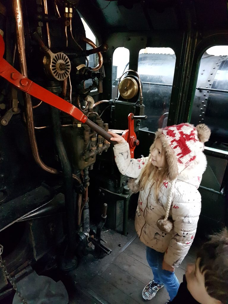 lois in drivers cabin of train