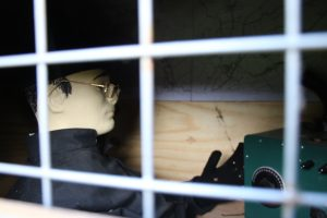 soldier manekin inside the chicken coop