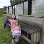 kids stood outside the chicken coop