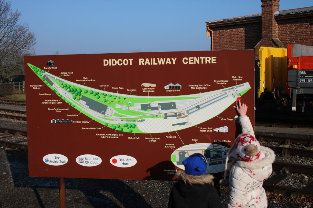 lois and cody looking at map of didcot railway centre