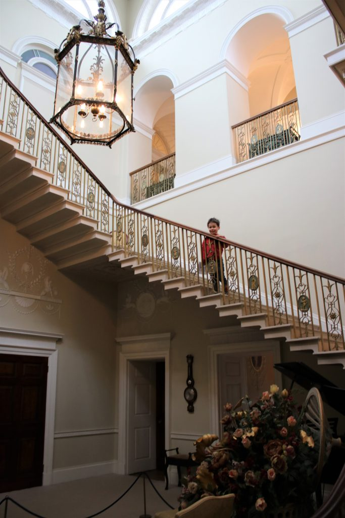 cody on the stairs at basildon park
