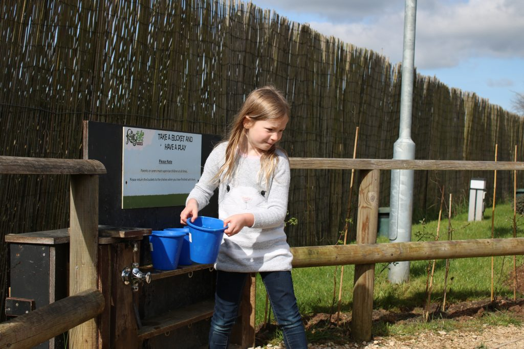 lois collecting buckets of water