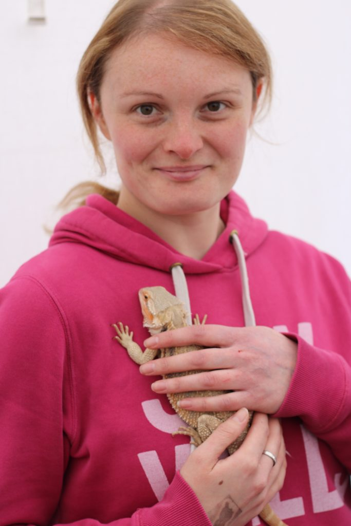 katie holding a bearded dragon