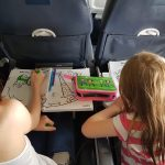 Lilian and lois doing colouring books on plane