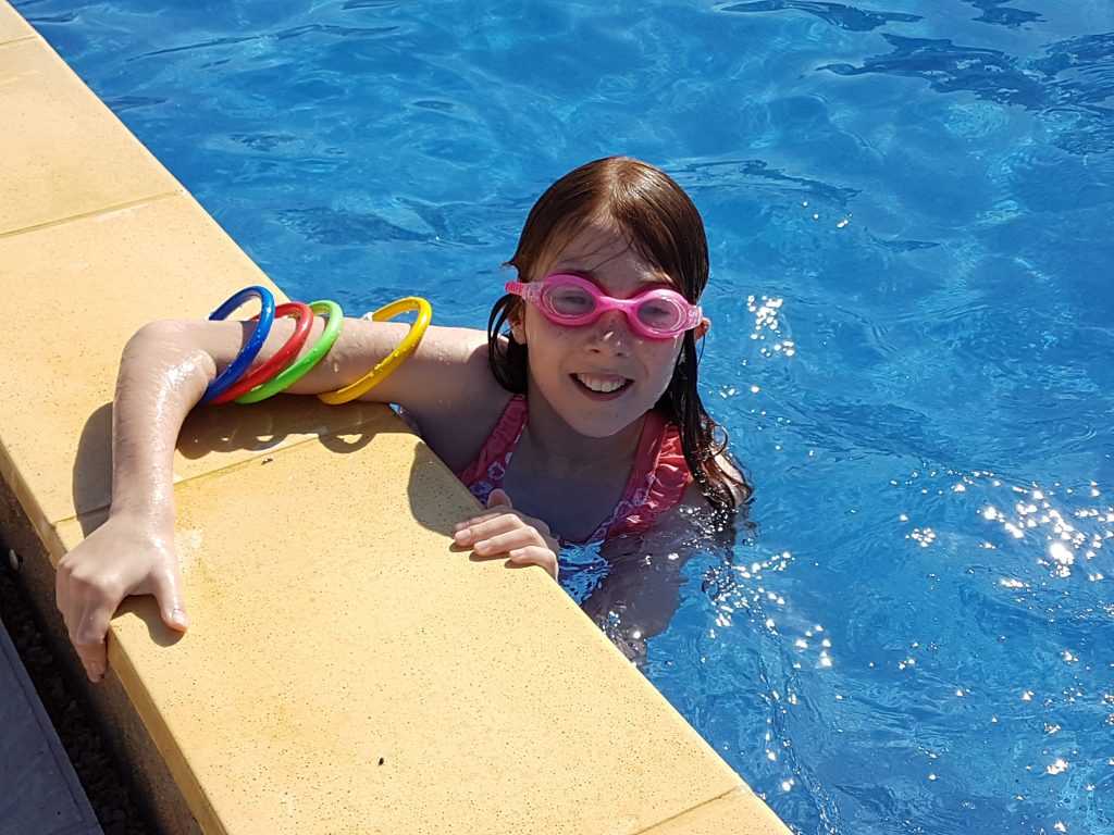 Lily in the pool with sinkers