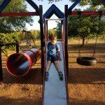 cody on slide in La Cabana play park