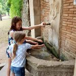 kids at the font by the monastery
