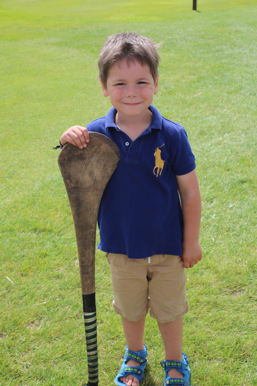 Cody holding hurling stick