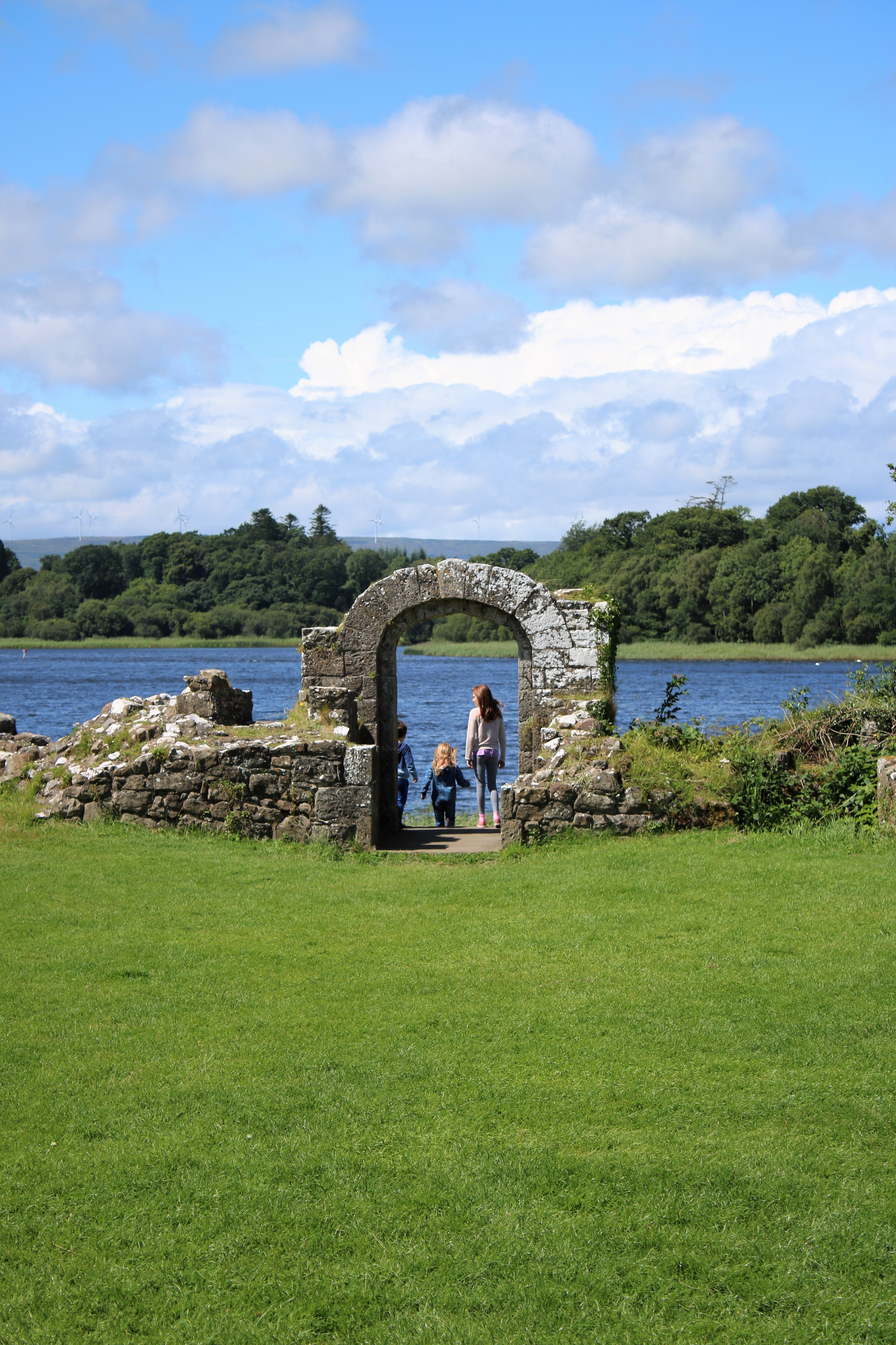 castle ruins archway overlooking lake