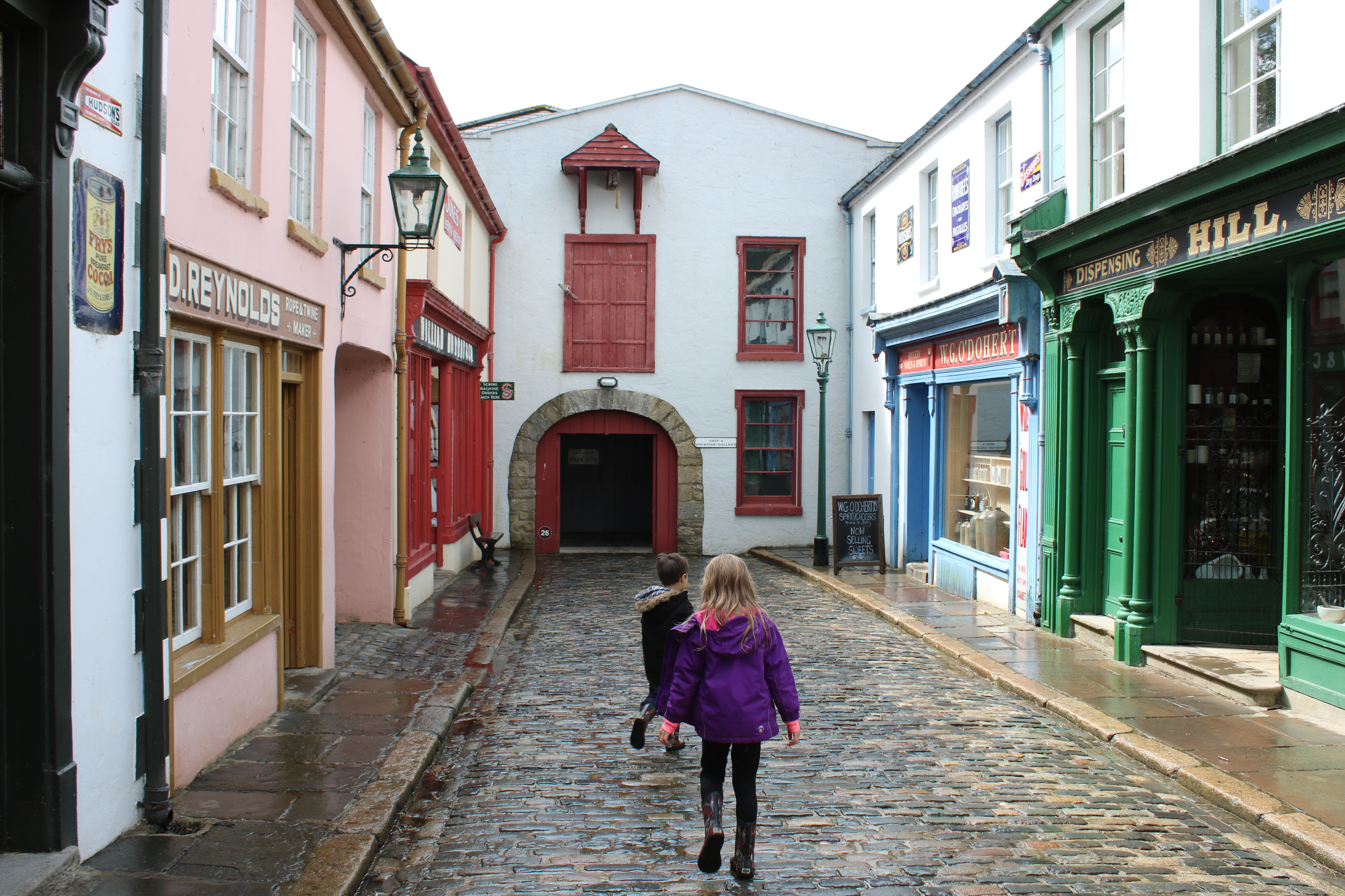 cobbled street with shops either side