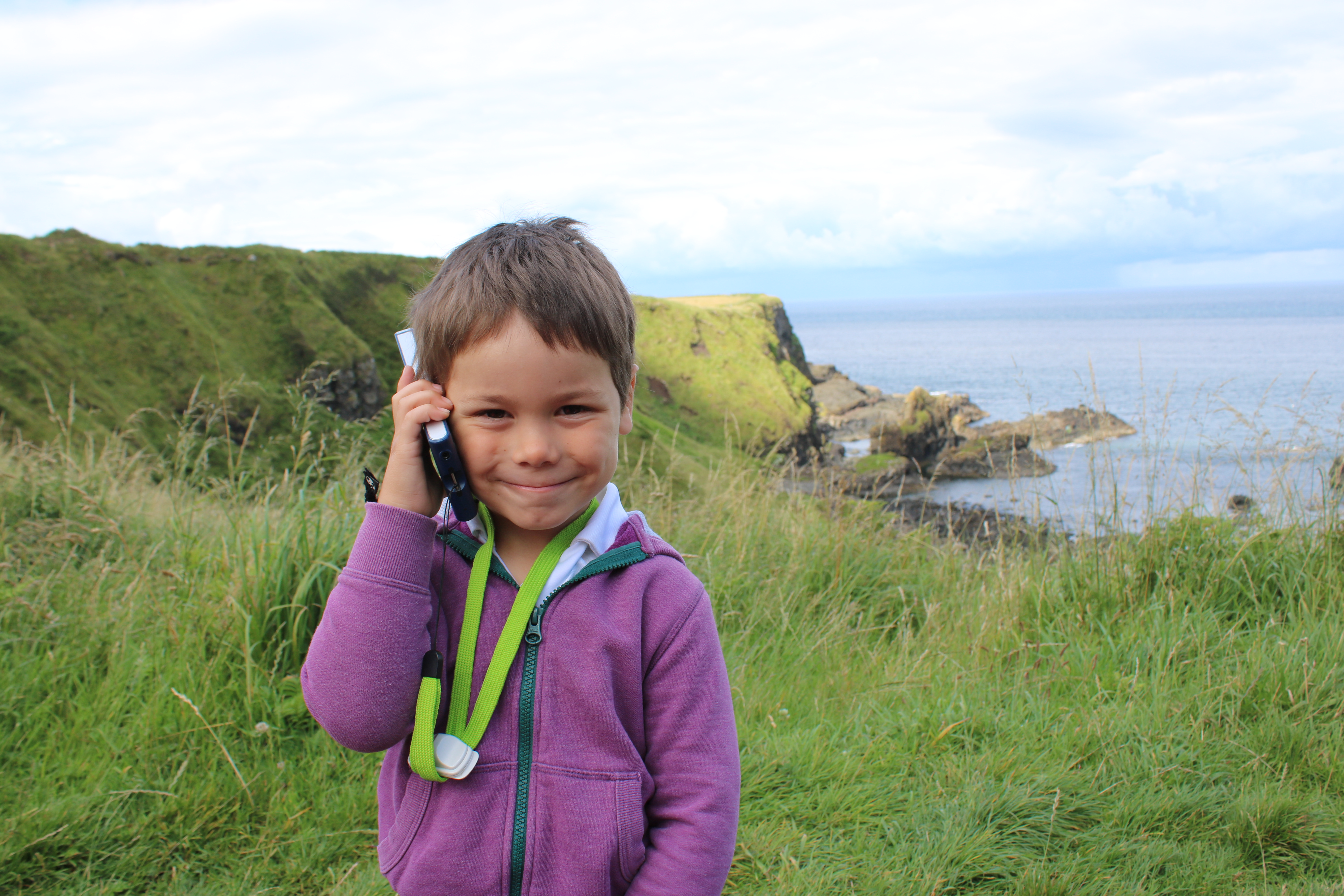 Cody listening to his audio tour at the Giants Causeway in Ireland