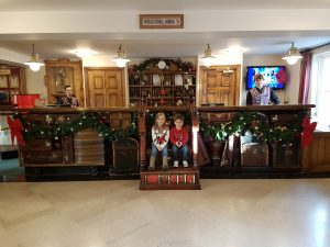 Reception desk at Alton Towers hotel decorated for Christmas