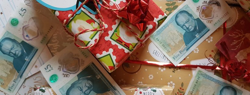 Christmas gifts and money £5 notes