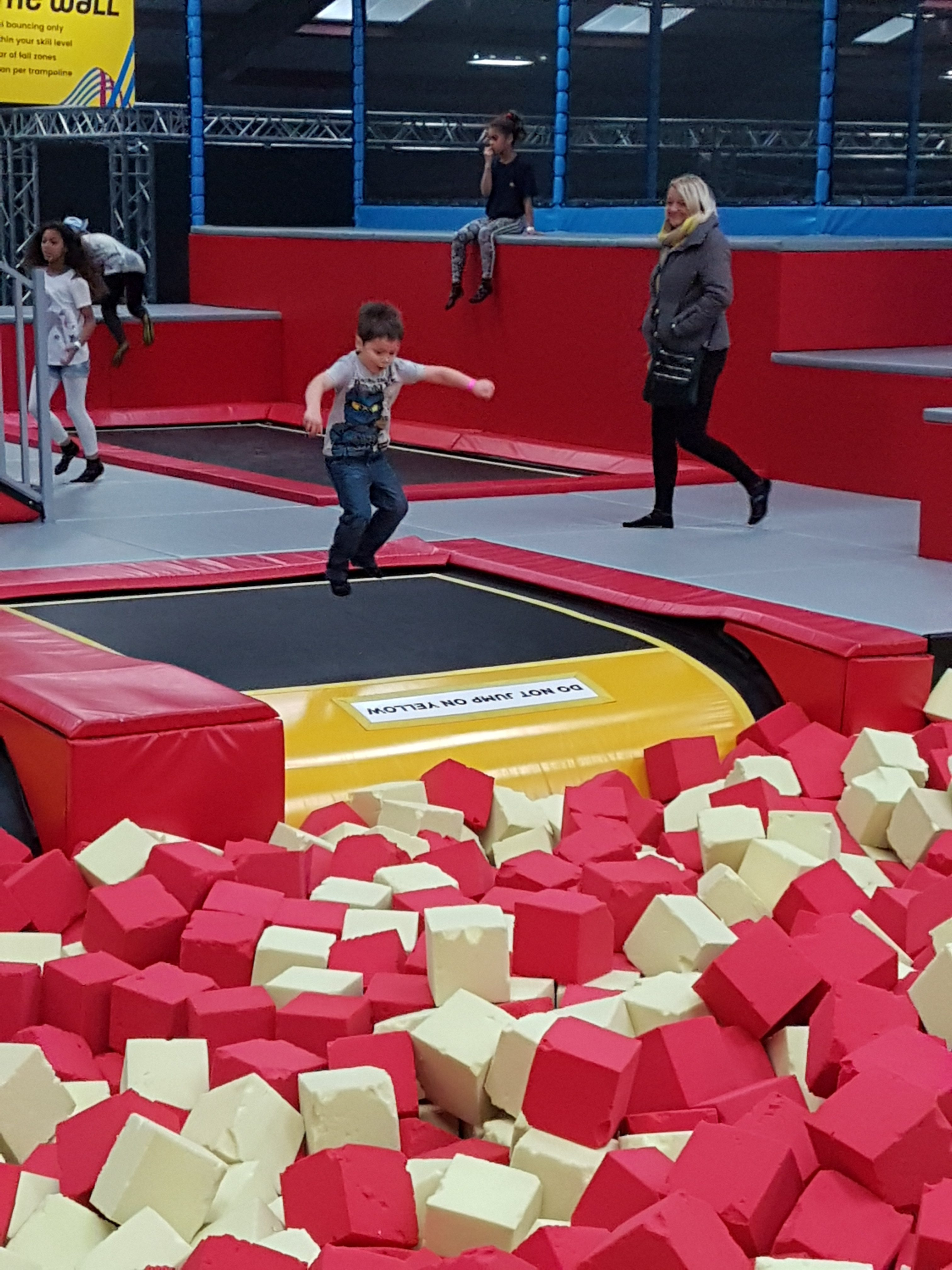 Jumping in to foam pit at Red Kangaroo Trampoline park Reading