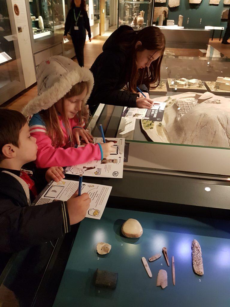 kids doing trail sheet in the ashmolean museum