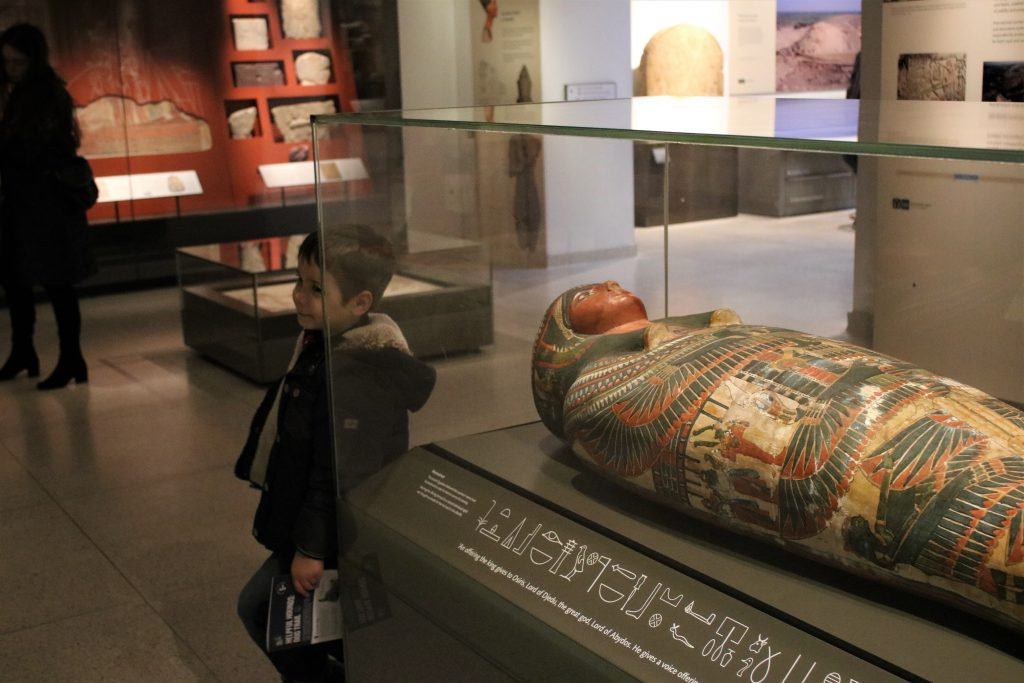 Cody stood next to Eyqptian sarcophagus