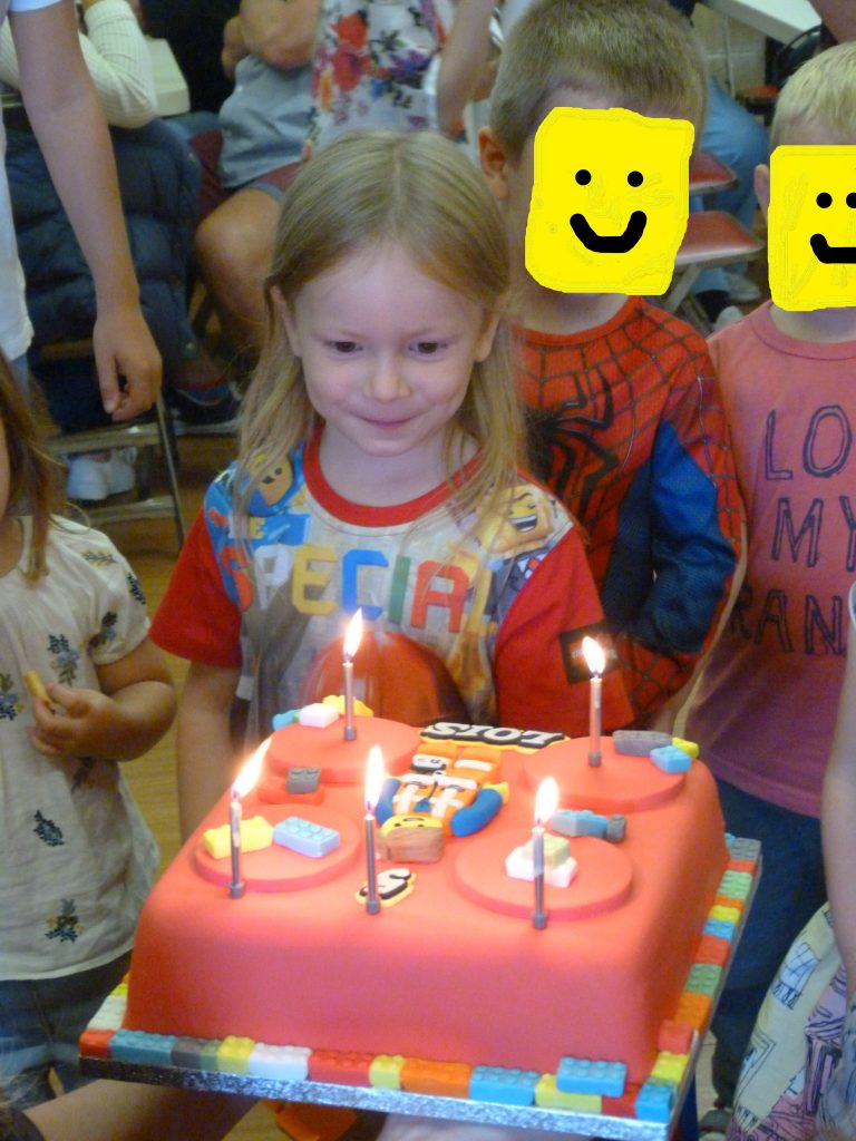 Lois with her Emmett birthday cake at her party