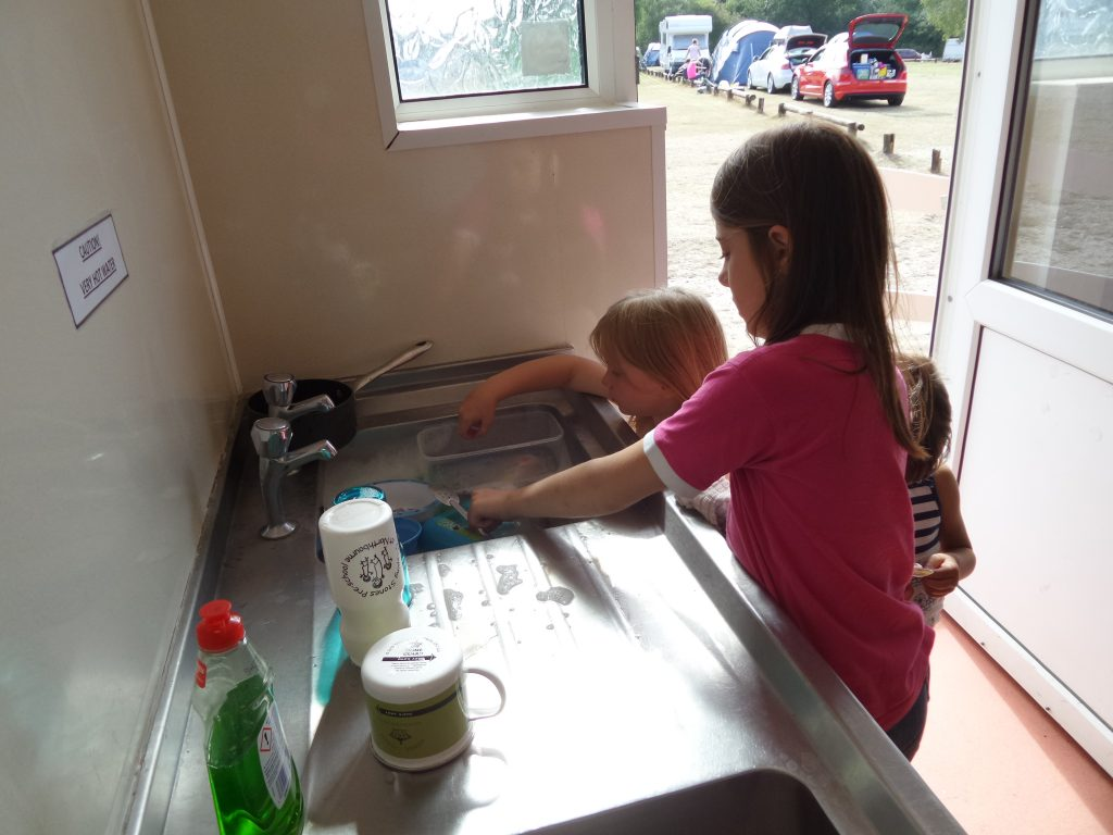 kids washing up at Holmsley campsite