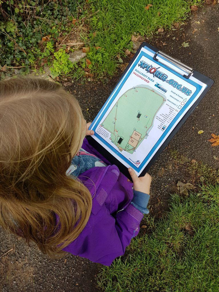 Xplorer orienteering map on a clipboard