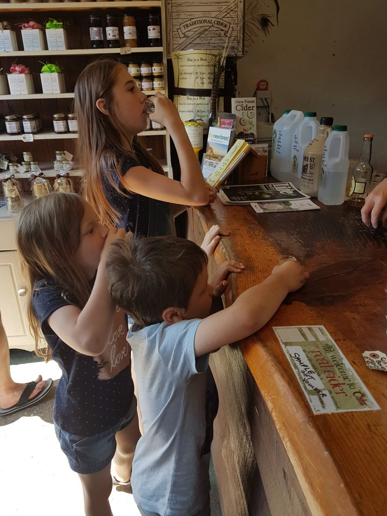 kids trying apple juice samples at the Cider Pantry