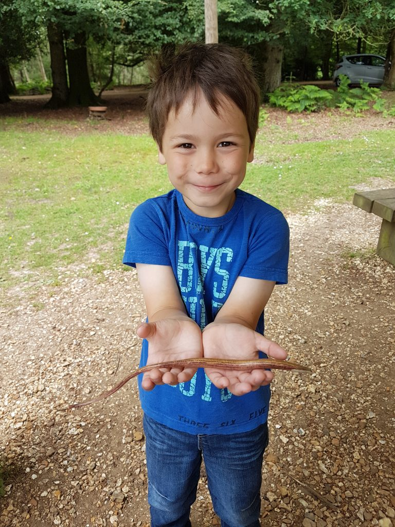 Cody holding a toy slow worm