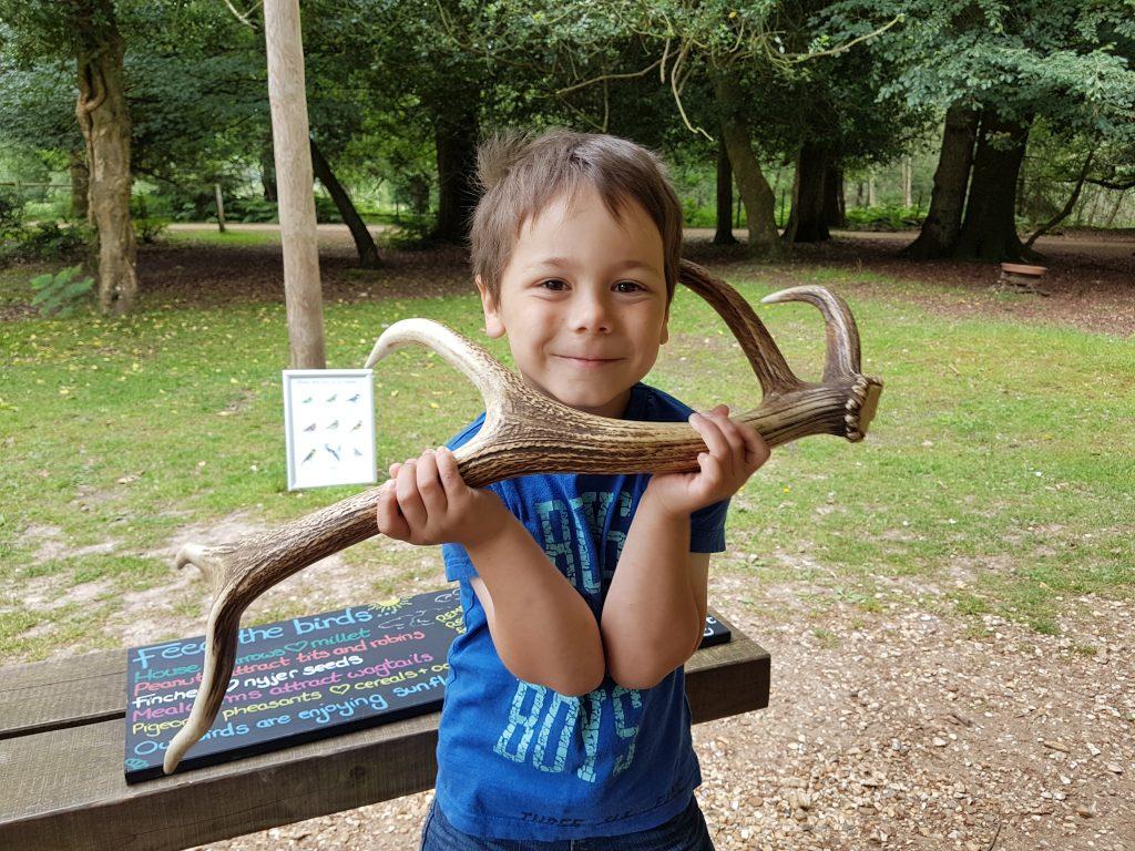 Cody holding a deer antler