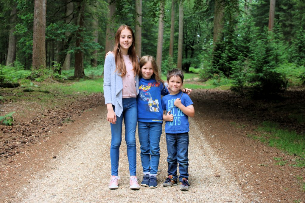 kids standing together on path in the new forest