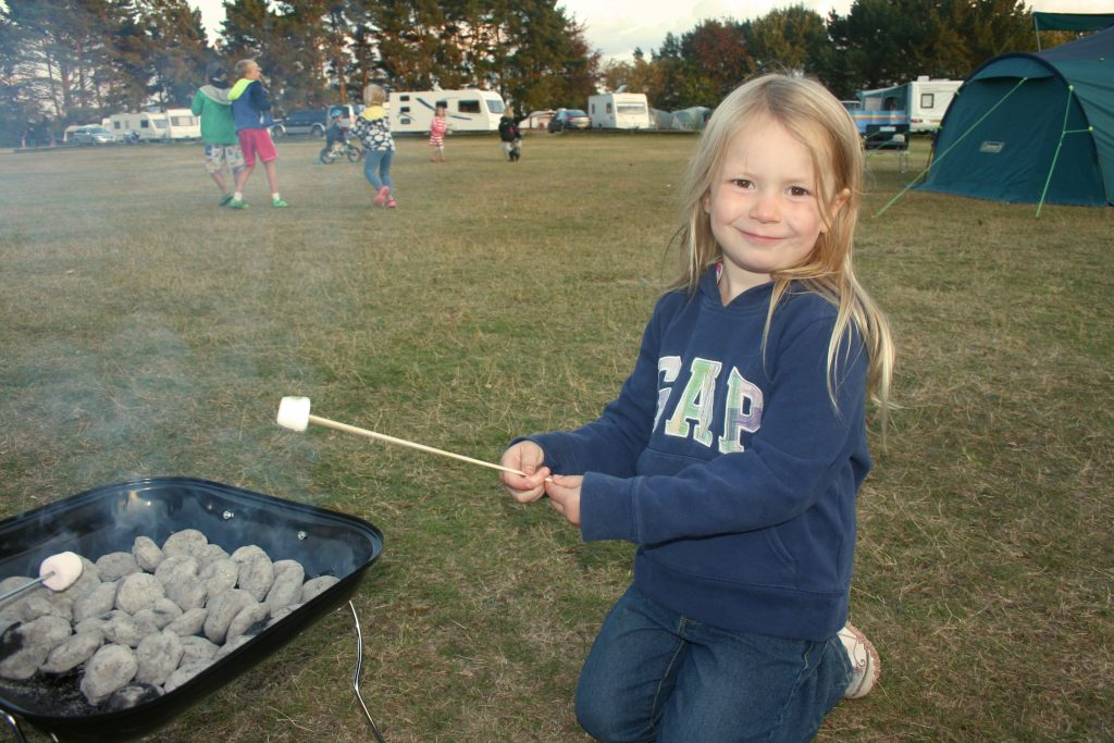 cooking marshmallows at the campsite