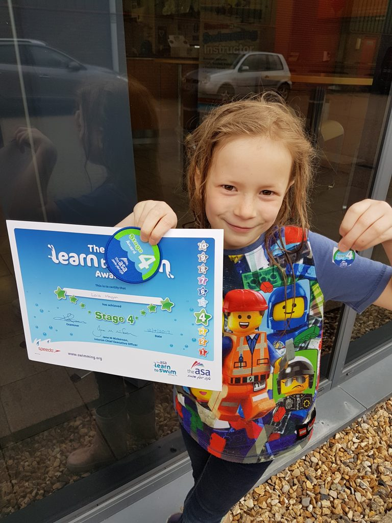 Lois with swim certificate