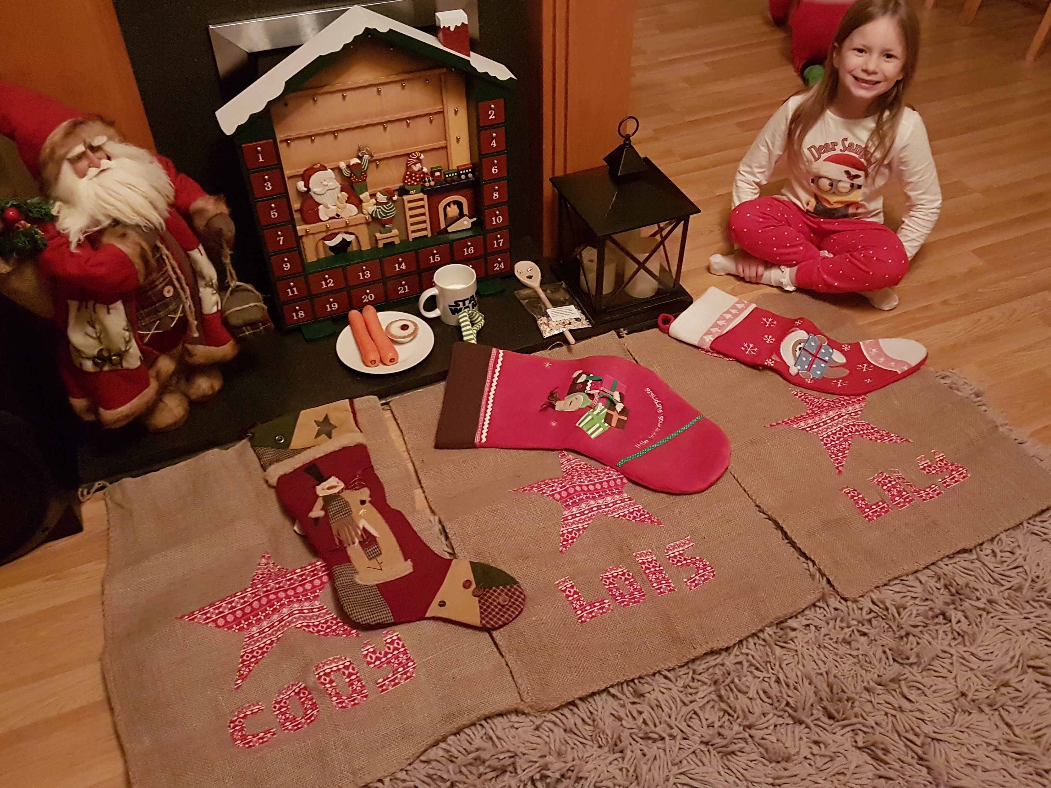 kids Christmas stockings and sacks laid by the fire